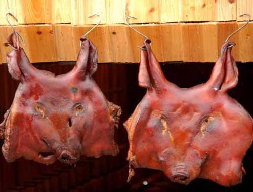 腊猪头加工技术_岳阳蝶式腊猪头制作方法